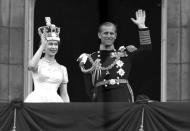 FILE - In this June 2, 1953 file photo, Britain's Queen Elizabeth II and her husband, the Duke of Edinburgh, wave from the balcony of Buckingham Palace, London, following the Queen's coronation at Westminster Abbey. Buckingham Palace says Prince Philip, husband of Queen Elizabeth II, has died aged 99. (AP Photo/Leslie Priest, File)