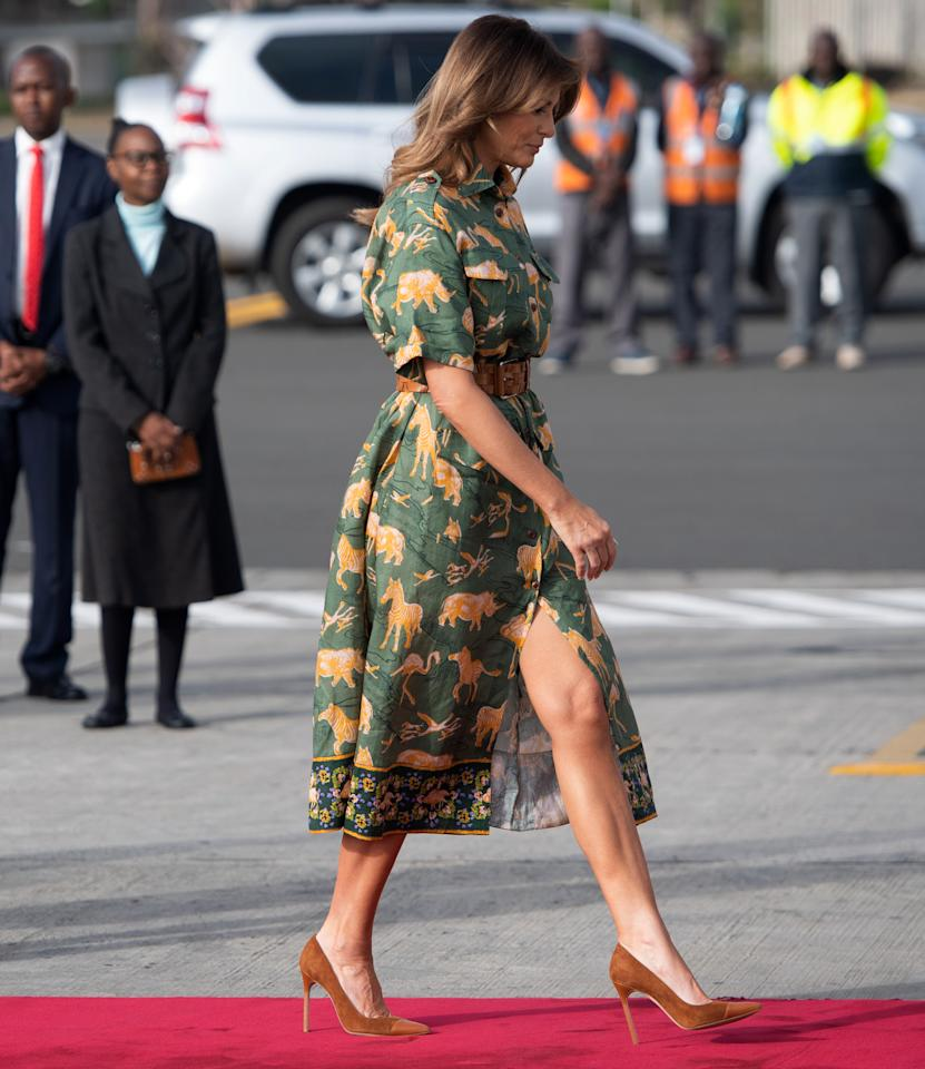 <p>Melania boarded her military plane for Cairo, Egypt, wearing an animal print shirt dress. The First Lady finished the look with a brown belt and matching heels. <em>[Photo: Getty]</em> </p>