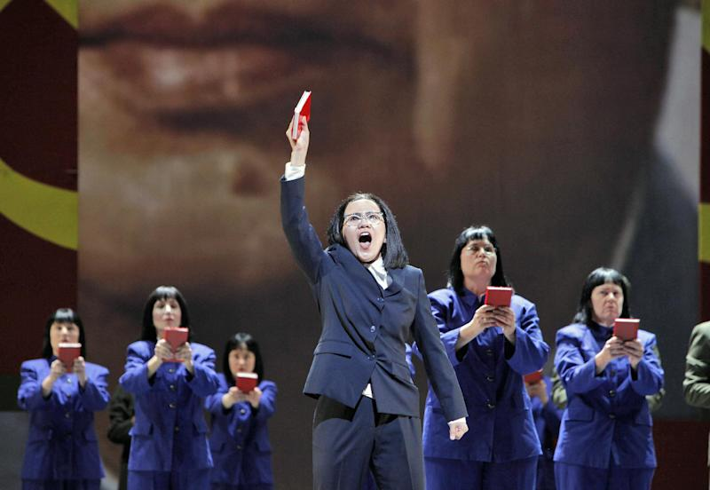 """In this June 5, 2012 handout photo provided by the San Francisco Opera, Hye Jung Lee, as Madame Mao, sings """"I am the Wife of Mao Tse-tung"""" during a scene from the final dress rehearsal of """"Nixon in China."""" The production, increasingly recognized as a modern masterpiece, is finally getting the recognition it deserves on the home ground of composer John Adams, in a sparkling production that highlights the San Francisco Opera's summer season. (AP Photo/San Francisco Opera, Cory Weaver, handout)"""