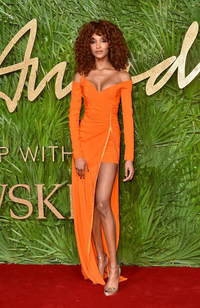 <p>Supermodel Jourdan Dunn sported a curly hair look as she graced the red carpet in an orange thigh-split dress. (Photo: Getty Images) </p>