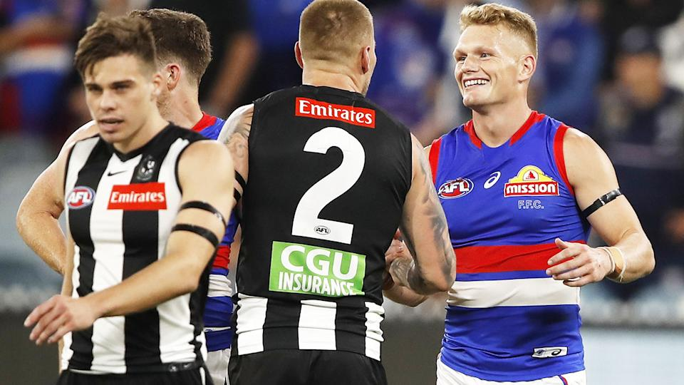 Adam Treloar, pictured here embracing his former teammates after the Western Bulldogs' win over Collingwood.