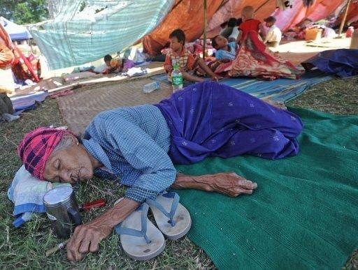 A victim of the recent earthquake in Mayanmar rests at a relief camp in Thabeik Kyin township, Mandalay. The quake left 26 people dead, 12 others missing and about 230 injured, the Red Cross says