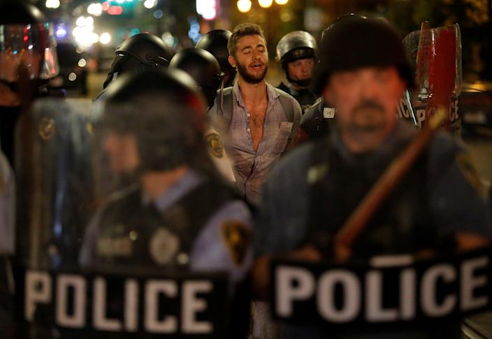 Police officers detain a man protesting on Sept. 16, the day after the not-guilty verdict in the murder trial of Jason Stockley, a white former St. Louis police officer, charged with the 2011 shooting of Anthony Lamar Smith, who was black. (Photo: Joshua Lott/Reuters)