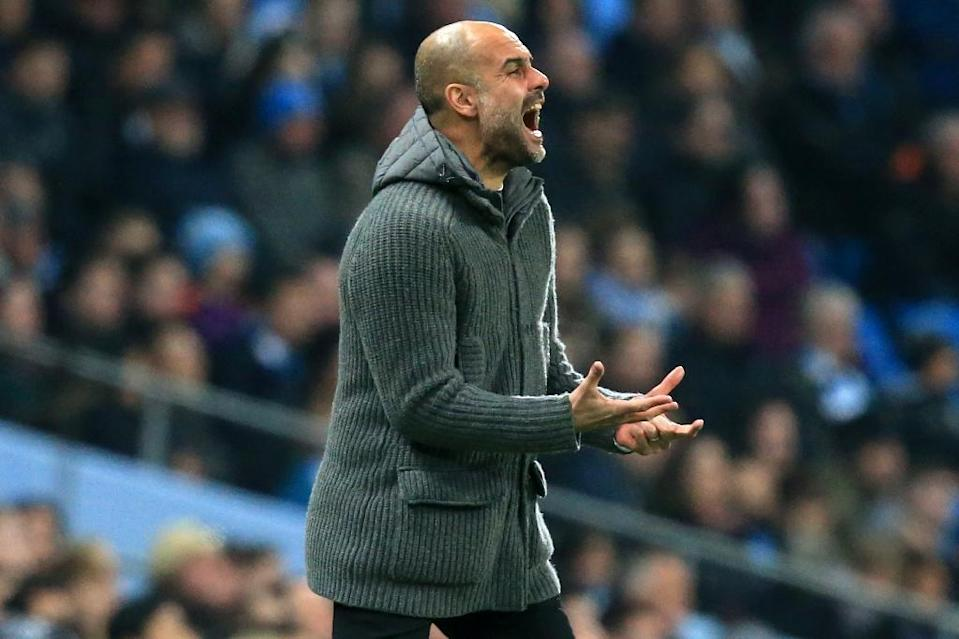 Pep Guardiola doesn't expect a smooth ride to the title (AFP Photo/Lindsey PARNABY)