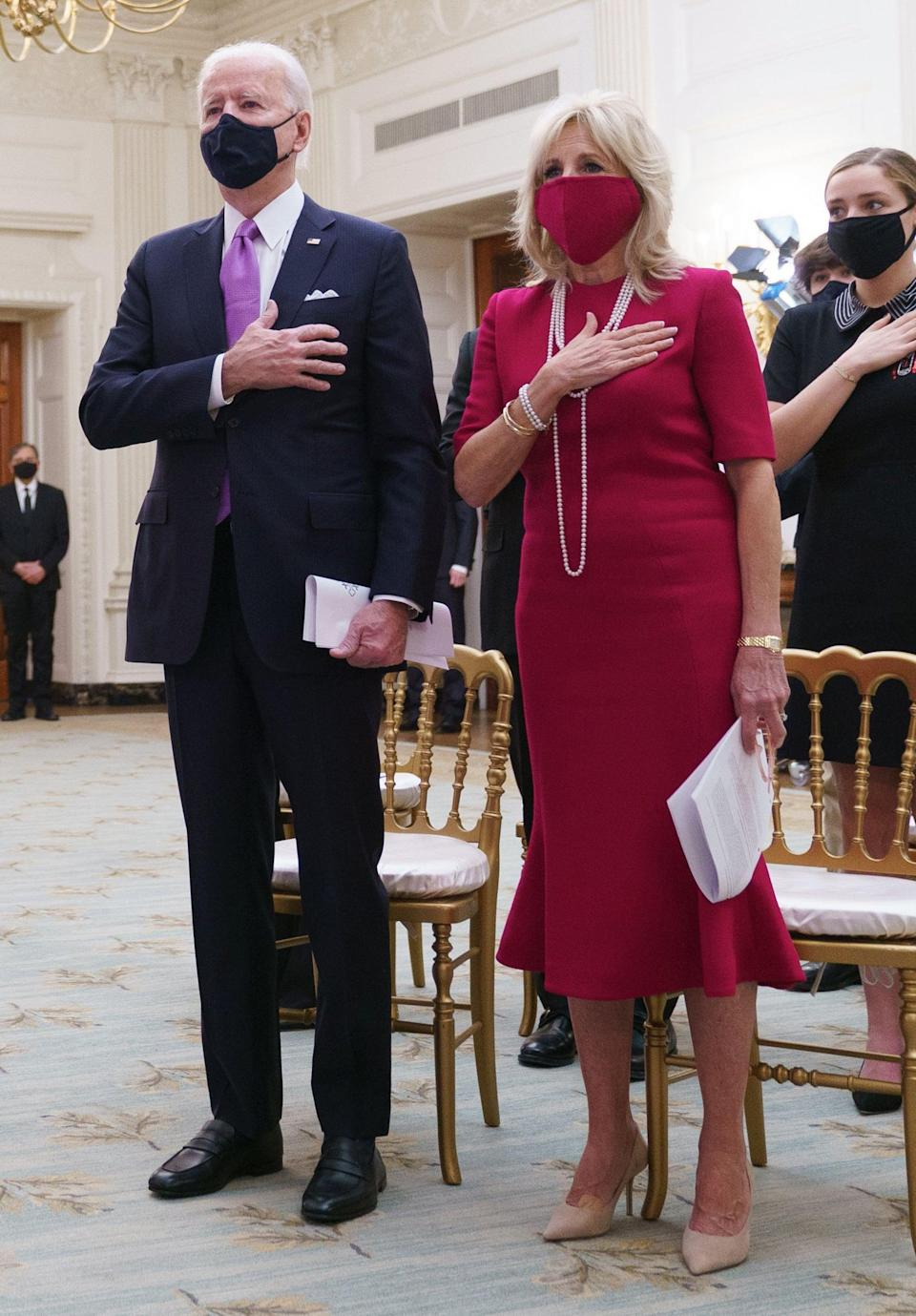 <p>Biden wearing Brandon Maxwell's red sheath with a fluted hem, coordinated with a matching Gigi Burris face mask, for the virtual Presidential Inaugural Prayer Service on Jan. 21, 2021.</p>