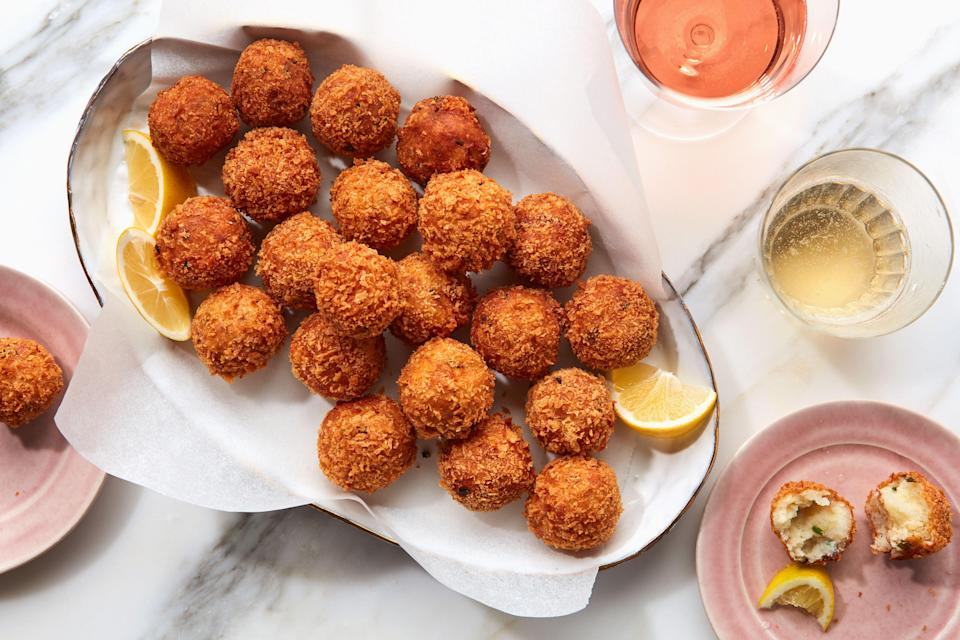 "An elegant pre-dinner snack that's crunchy, savory, creamy, and luscious. They're as great with pilsner as they are with Champagne. <a href=""https://www.epicurious.com/recipes/food/views/smoked-trout-croquettes?mbid=synd_yahoo_rss"" rel=""nofollow noopener"" target=""_blank"" data-ylk=""slk:See recipe."" class=""link rapid-noclick-resp"">See recipe.</a>"