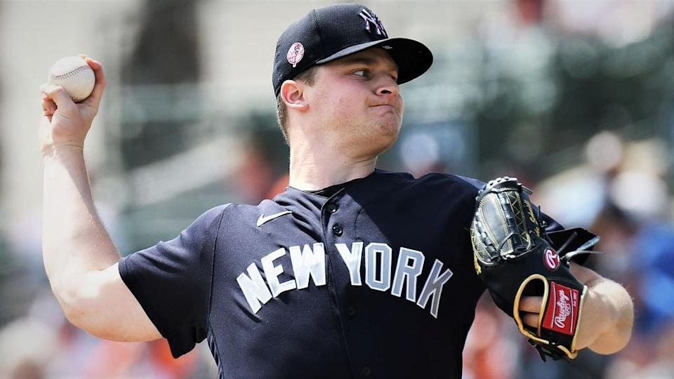 Yankees pitcher Clarke Schmidt throws pitch against Baltimore Orioles