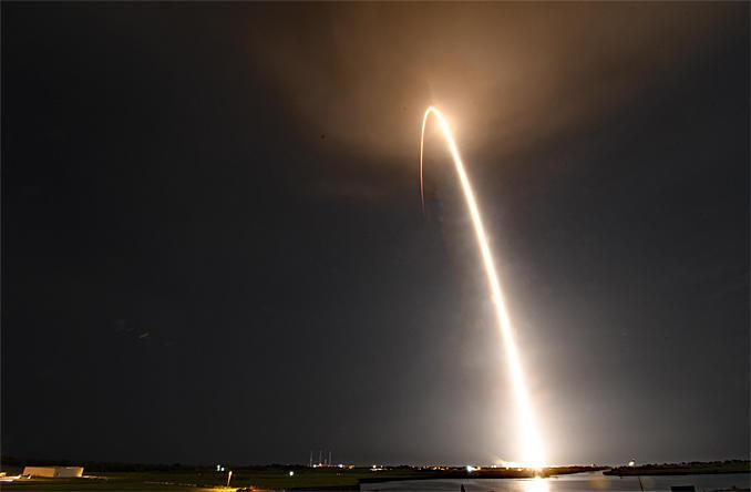 A SpaceX Falcon 9 rocket powered by a first stage making its fifth flight streaked away from Cape Canaveral early Friday, boosting 57 Starlink internet relay stations into orbit along with two commercial remote sensing satellites. A time exposure captures the rocket's fiery trajectory as it climbed away from the Kennedy Space Center. / Credit: William Harwood/CBS News