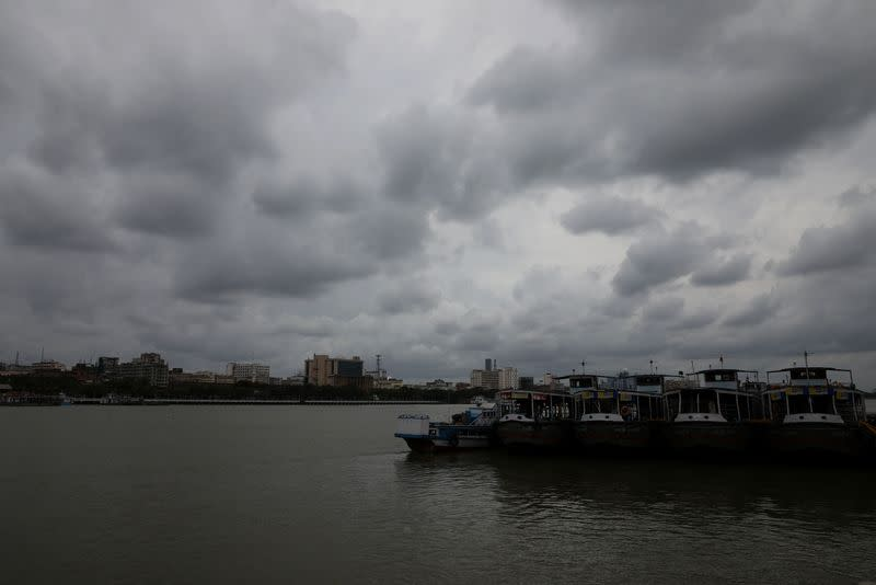 Clouds cover the skies over the river Ganges ahead of Cyclone Amphan, in Kolkata