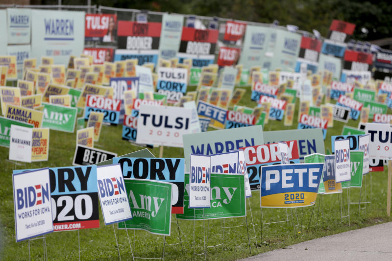 Election signs of the various democratic candidates are planted at the Polk County Democrats Steak Fry, in Des Moines, Iowa, Saturday, Sept. 21, 2019. (AP Photo/Nati Harnik)