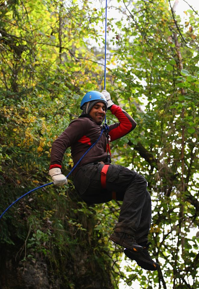 NUREMBERG, GERMANY - SEPTEMBER 26:  England all rounder Ravi Bopara enjoys himself as he abseils down the rockface during an abseiling excercise at the England Cricket squad Pre Ashes Training Camp on September 26, 2010 near Nuremberg, Germany.  (Photo by Stu Forster/Getty Images)