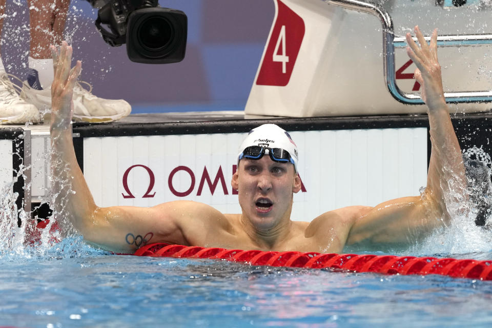 Chase Kalisz, of the United States, celebrates after winning the final of the men's 400-meter individual medley at the 2020 Summer Olympics, Sunday, July 25, 2021, in Tokyo, Japan. (AP Photo/Martin Meissner)