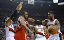 Houston Rockets' Terrence Jones (6) passes against Portland Trail Blazers' Thomas Robinson (41) during the first half of game six of an NBA basketball first-round playoff series game in Portland, Ore., Friday May 2, 2014. (AP Photo/Greg Wahl-Stephens)