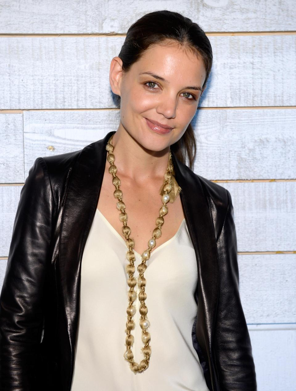 """<div class=""""caption-credit""""> Photo by: Kevin Mazur/WireImage/Getty</div>In addition to a few elite magazine editors, former <i>American Idol</i> contestant Katharine McPhee and make-up artist Bobbi Brown, who just signed Holmes as spokeswoman for her cosmetics line, gathered for the event. Holmes <a rel=""""nofollow noopener"""" href=""""http://yhoo.it/NLBYpA"""" target=""""_blank"""" data-ylk=""""slk:daughter Suri"""" class=""""link rapid-noclick-resp"""">daughter Suri</a>, however, was a no-show. (Burn? No, she started school this week.) <br>"""