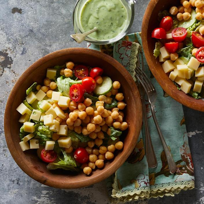 <p>In this cucumber, tomato, Swiss cheese and chickpea salad recipe, a healthy green goddess dressing is made from avocado, buttermilk and herbs. The extra dressing is delicious served with grilled vegetables.</p>