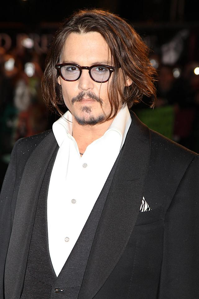 """<a href=""""http://movies.yahoo.com/movie/contributor/1800019485"""">Johnny Depp</a> at the London premiere of <a href=""""http://movies.yahoo.com/movie/1810078365/info"""">Alice in Wonderland</a> - 02/25/2010"""