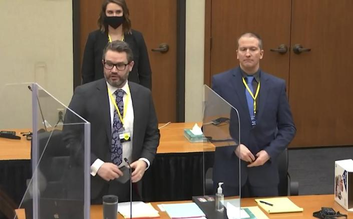 In this image taken from video, defense attorney Eric Nelson, left, and defendant former Minneapolis police officer Derek Chauvin, right, and Nelson's assistant Amy Voss, back, introduce themselves to potential jurors as Hennepin County Judge Peter Cahill presides, prior to continuing jury selection, Monday, March 15, 2021, in the trial of Chauvin, at the Hennepin County Courthouse in Minneapolis, Minn. Chauvin is charged in the May 25, 2020, death of George Floyd. (Court TV, Pool via AP)