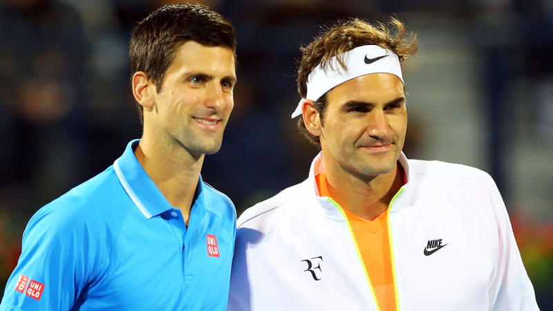 Roger Federer and Novak Djokovic pose for a photo before a match.