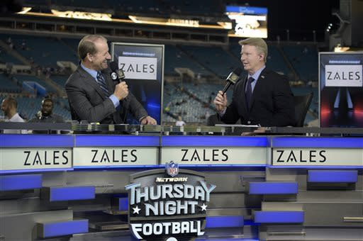 Phil Simms may not have a clear role with CBS' football crew next season, but the Frisco Roughriders are ready to bring him into their booth. (AP Photo/Phelan M. Ebenhack, File)