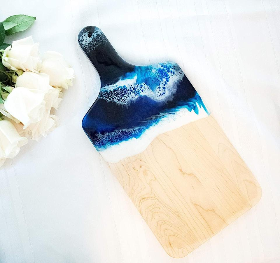 <p>If you love charcuterie boards, this <span>Ocean Theme Wood Serving Board</span> ($75) will make you feel like your at the beach.</p>