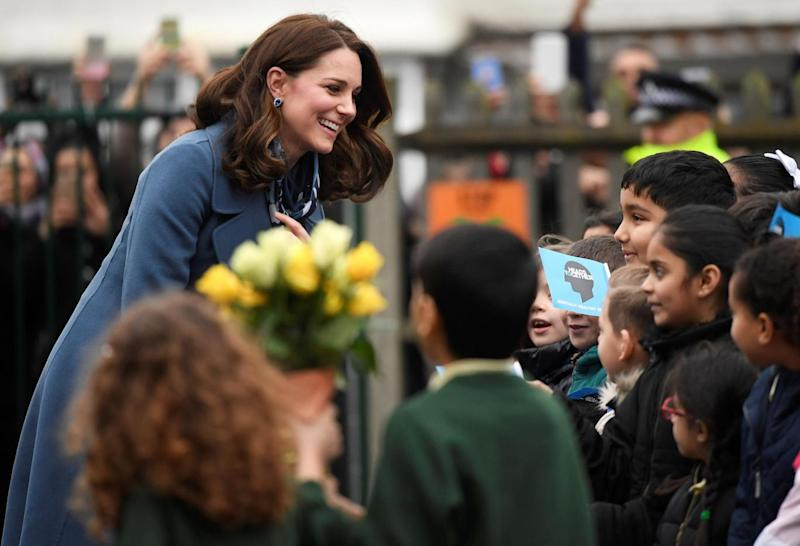 Kate was handed flowers by school pupils (Reuters)