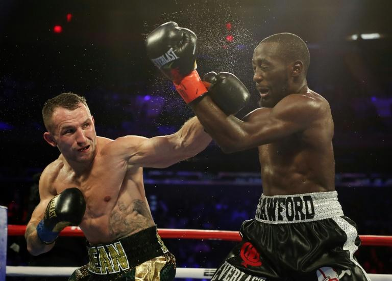 Egidijus Kavaliauskas lands a left to the face of American Terence Crawford who retained his WBO title at Madison Square Garden