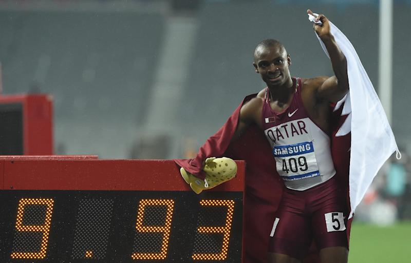 Qatar's Femi Ogunode celebrates after setting a new Asian 100m record of 9.93 sec at the Asian Games in Incheon, South Korea on September 28, 2014 (AFP Photo/Philippe Lopez)