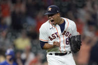 Houston Astros starting pitcher Bryan Abreu reacts after striking out Texas Rangers' Nick Solak during the 10th inning of a baseball game Thursday, May 13, 2021, in Houston. (AP Photo/David J. Phillip)