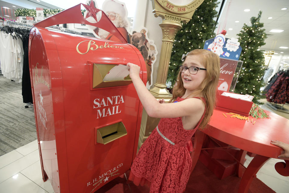 IMAGE DISTRIBUTED FOR MACY'S - Macy's celebrates National Believe Day by helping Make-A-Wish grant 25 Wishes Across America, including Allison Schmidt, 9, of Fernandina Beach, Fla. Schmidt drops off a letter to Santa Claus as part of the 11th Annual Macy's Believe Campaign at the Macy's Florida Mall on Friday, Dec. 7, 2018, in Orlando, Fla. (Phelan M. Ebenhack/AP Images for Macy's)