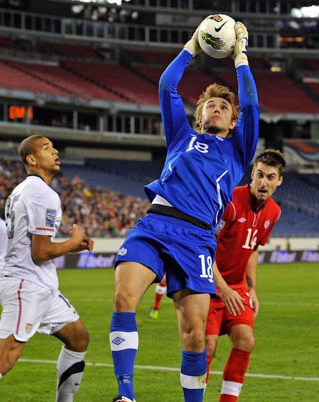 NASHVILLE, TN - MARCH 24: Goalkeeper Michal Misiewicz #18 of Canada jumps to make a save against the USA in a 2012 CONCACAF Men's Olympic Qualifying match at LP Field on March 24, 2012 in Nashville, Tennessee. (Photo by Frederick Breedon/Getty Images)