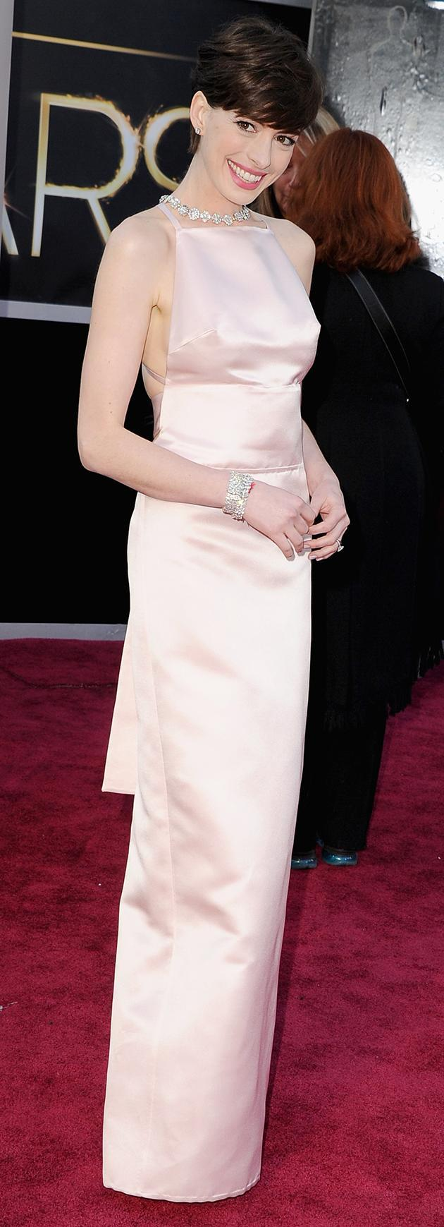Anne Hathaway didn't wear a bra as she hit the Oscars 2013 red carpet. Copyright [Getty]
