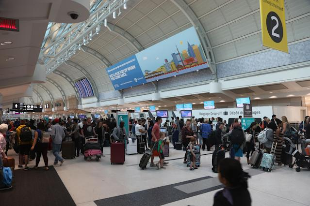 Passengers check in for flights at Lester B. Pearson International Airport in Mississauga, Ontario, Canada. Pearson International Airport is Canada's largest and busiest airport. (Photo by Creative Touch Imaging Ltd./NurPhoto via Getty Images)