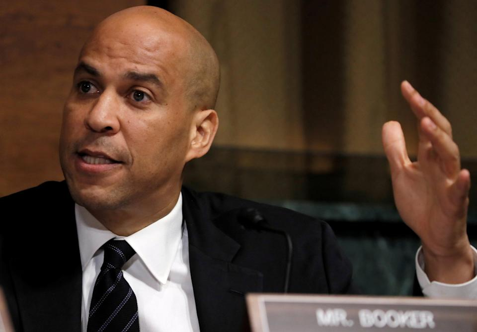 FILE PHOTO: U.S. Senator Cory Booker (D-NJ) speaks as members of the Senate Judiciary Committee meet to vote on the nomination of judge Brett Kavanaugh to be a U.S. Supreme Court associate justice on Capitol Hill in Washington, U.S., September 28, 2018. REUTERS/Jim Bourg