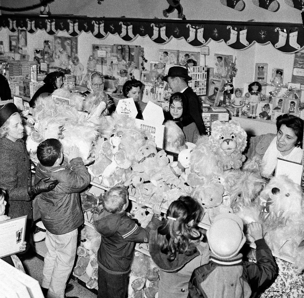 "FILE - In this Dec. 8, 1964, file photo, stuffed animals draw the attention of shoppers in a Sears department store in downtown Chicago. Sears, a back-to-school shopping destination for generations of kids and the place newlyweds went to choose appliances, said Tuesday, March 21, 2017, that after years of losing money that there is ""substantial doubt"" it will be able to keep its doors open. (AP Photo/LO, File)"