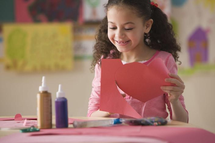 """<p>As any teacher will tell you, Valentine's Day is a fantastic crafting holiday. From <a href=""""https://www.countryliving.com/diy-crafts/how-to/g2963/diy-valentines-day-cards/"""" rel=""""nofollow noopener"""" target=""""_blank"""" data-ylk=""""slk:DIY Valentine's Day cards"""" class=""""link rapid-noclick-resp"""">DIY Valentine's Day cards</a> to the <a href=""""https://www.countryliving.com/diy-crafts/g25844424/valentines-day-boxes/"""" rel=""""nofollow noopener"""" target=""""_blank"""" data-ylk=""""slk:Valentine's Day boxes"""" class=""""link rapid-noclick-resp"""">Valentine's Day boxes</a> to put them in, there's no shortage of Valentine's Day crafts for kids. There are so many heart-shaped activities to get your kids involved in that will fill the house with some beautiful <a href=""""https://www.countryliving.com/diy-crafts/g1093/valentine-day-crafts/"""" rel=""""nofollow noopener"""" target=""""_blank"""" data-ylk=""""slk:Valentine's Day crafts"""" class=""""link rapid-noclick-resp"""">Valentine's Day crafts</a>. There are easy creations here for kids of all ages, whether you're hoping to let your toddler, preschooler, or middle schooler stretch their creativity. Try the heart stamps made out of toilet paper rolls, cute love bug hats that your littlest ones can create with paint and stickers, or fun tote bags decorated with puffy paint. </p><p>You can also have them turn their <a href=""""https://www.countryliving.com/food-drinks/g1605/heart-shaped-desserts-valentines-day/"""" rel=""""nofollow noopener"""" target=""""_blank"""" data-ylk=""""slk:Valentine's Day treats"""" class=""""link rapid-noclick-resp"""">Valentine's Day treats</a> into a craft themselves by making a robot out of different candies or a wreath constructed out of sweets. Make some colorful heart suncatchers or a fingerprint tree that you can decorate the house with leading up to February 14. Pair one of these ideas with a fun <a href=""""https://www.countryliving.com/diy-crafts/g25916974/valentines-day-games/"""" rel=""""nofollow noopener"""" target=""""_blank"""" data-ylk=""""slk:Valentine's Day game"""" class=""""link rapid-nocli"""