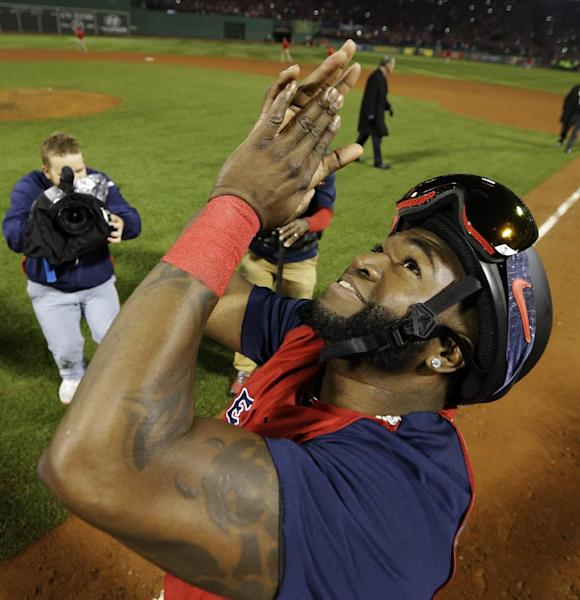 Boston Red Sox designated hitter David Ortiz applauds after defeating the St. Louis Cardinals in Game 6 of baseball's World Series Wednesday, Oct. 30, 2013, in Boston. The Red Sox won 6-1 to win the series. (AP Photo/David J. Phillip)