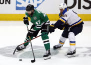 Dallas Stars right wing Alexander Radulov (47) attempts to keep control of the puck while under pressure from St. Louis Blues center Ryan O'Reilly (90) in the third period of Game 6 of an NHL second-round hockey playoff series in Dallas, Sunday, May 5, 2019. (AP Photo/Tony Gutierrez)