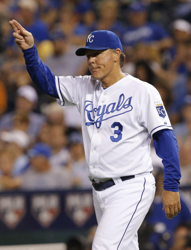 Kansas City Royals manager Ned Yost calls for a new pitcher during the fourth inning of a baseball game against the Detroit Tigers at Kauffman Stadium in Kansas City, Mo., Friday, Sept. 6, 2013. (AP Photo/Orlin Wagner)