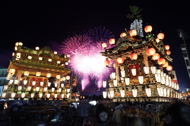 In this Tuesday, Dec. 3, 2019, file photo, lantern-covered floats stand as fireworks light up the sky during the Chichibu Night Festival in Chichibu, north of Tokyo, Japan. The Chichibu Night Festival, which has roots that go back more than 1,000 years, is one of three famous Japanese festivals to feature huge floats, which can top 7 meters (23 feet) and weigh up to 15 tons. (AP Photo/Toru Hanai, File)