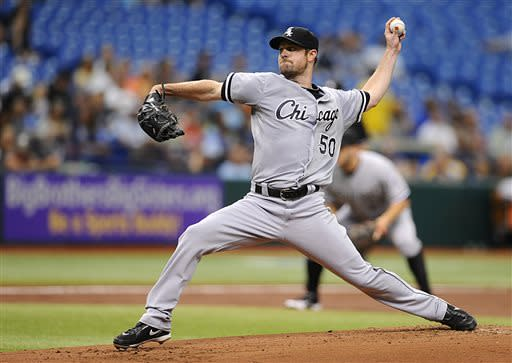 Chicago White Sox starting pitcher John Danks delivers to the Tampa Bay Rays during the first inning of a baseball game on Sunday, July 7, 2013, in St. Petersburg, Fla. (AP Photo/Brian Blanco)