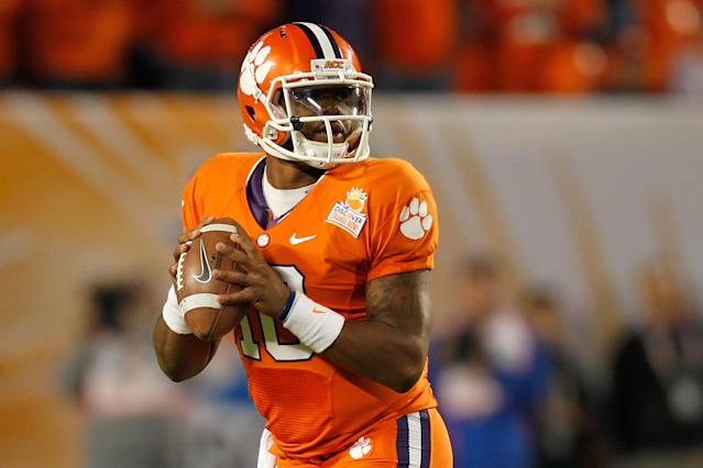 MIAMI GARDENS, FL - JANUARY 04: Tajh Boyd #10 of the Clemson Tigers looks to pass against the West Virginia Mountaineers during the Discover Orange Bowl at Sun Life Stadium on January 4, 2012 in Miami Gardens, Florida. (Photo by Streeter Lecka/Getty Images)