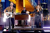 """<p>Set against Nashville's skyline, the country band — made up of Hillary Scott, Charles Kelley, and Dave Haywood — energized the show with their waterfront performance of """"Like A Lady.""""</p>"""
