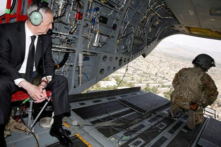 FILE PHOTO: U.S. Defense Secretary James Mattis looks out over Kabul as he arrives via helicopter at Resolute Support headquarters in Kabul, Afghanistan April 24, 2017. REUTERS/Jonathan Ernst/File Photo