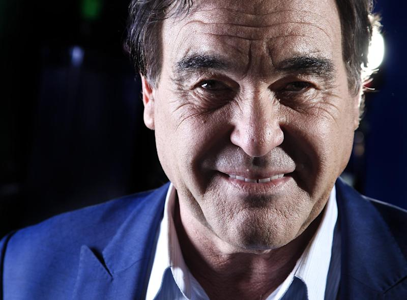 """In this Wednesday, Nov. 14, 2012, photo, American film director, screenwriter and producer Oliver Stone poses for a portrait in New York. Oliver Stone has never been shy about ruffling feathers with his take real-life events. From """"J.F.K"""" and """"Nixon,"""" to """"Salvador"""" and """"W,"""" Stone has challenged the history that we know by incorporating a revisionist view. His latest project, """"The Untold History of the United States,"""" a ten-part series, currently on the premium Showtime network, explores the facts he feels were suppressed for one reason or another. (Photo by Carlo Allegri/Invision/AP)"""