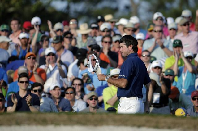 Spectators cheer as Bubba Watson walks up the 18th fairway during the third round of the Masters golf tournament Saturday, April 12, 2014, in Augusta, Ga. (AP Photo/Chris Carlson)