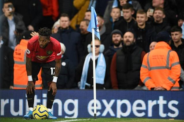 Manchester United midfielder Fred was hit by objects and allegedly targeted with racist abuse by a Manchester City supporter (AFP Photo/Oli SCARFF )
