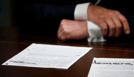 """U.S. President Donald Trump's prepared remarks show his own handwritten note """"There was no collusion"""" at the top as he speaks about his summit meeting with Russian President Vladimir Putin at the start of a meeting with members of the U.S. Congress at the White House in Washington, July 17, 2018. REUTERS/Leah Millis"""