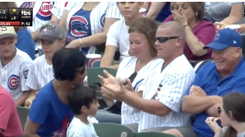 Cubs Fan Takes Foul Ball Intended For Kid, But The Little Guy Still Wins