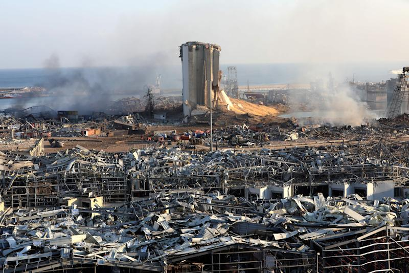 TOPSHOT - A view shows the aftermath of yesterday's blast at the port of Lebanon's capital Beirut, on August 5, 2020. - Rescuers worked through the night after two enormous explosions ripped through Beirut's port, killing at least 78 people and injuring thousands, as they wrecked buildings across the Lebanese capital. (Photo by Anwar AMRO / AFP) (Photo by ANWAR AMRO/AFP via Getty Images)