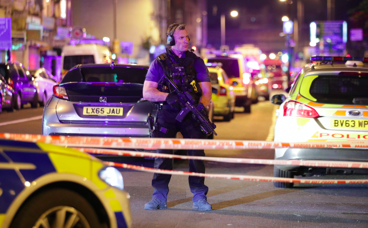 Armed police stand guard after pedestrians were ploughed into (PA)